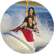 Couple having fun riding a jet ski in the water