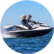 jetski with two girls riding though ocean
